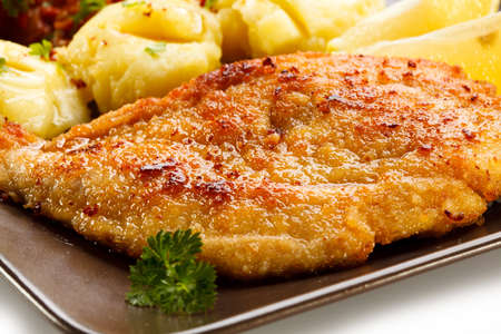 cutlets: Pork chops, mashed potatoes and vegetable salad Stock Photo