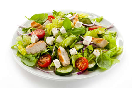 Vegetable salad with white cheese and roast chcicken meat
