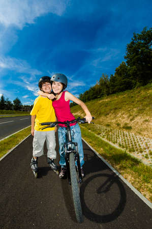 rollerblading: Active young people - rollerblading, cycling