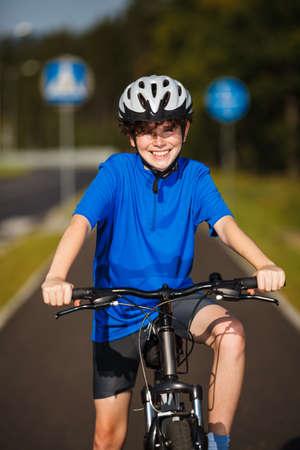 Healthy lifestyle - teenage boy biking photo