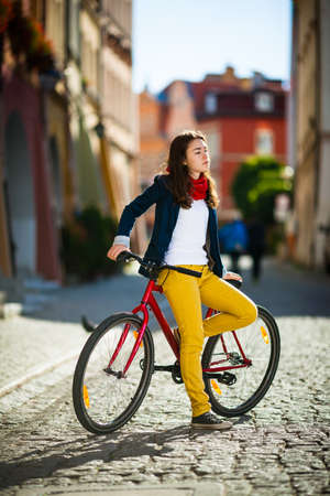 Urban biking - teenage girl and bike in city photo
