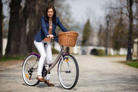 40 45: Urban biking - middle-age woman and bike in city