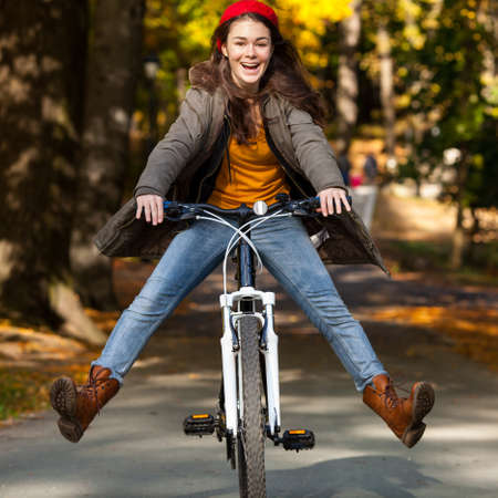 sporting activity: Urban biking - girl and bike in city park