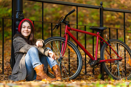 Urban biking - girl and bike in city park Stock Photo - 22114131