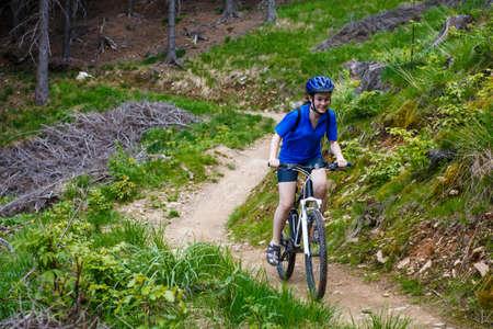 bicyclist: Healthy lifestyle - teenage girl biking