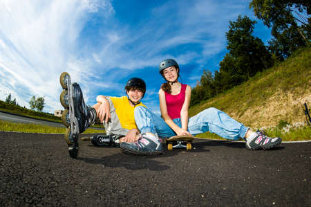 Active young people with rollerblading and skateboarding photo