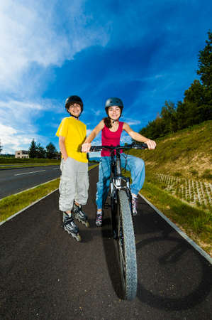 Active young people rollerblading and cycling photo