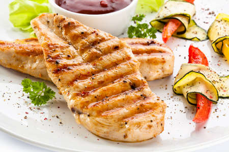 breasts: Grilled chicken breasts and vegetables