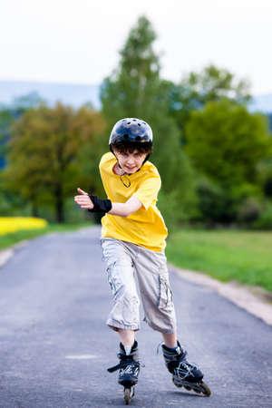 rollerskating: Boy rollerblading Stock Photo