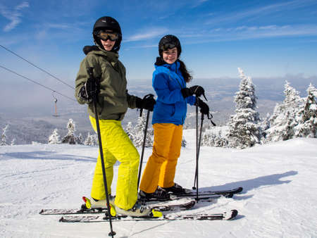 Teenage girl and boy skiing Stock Photo