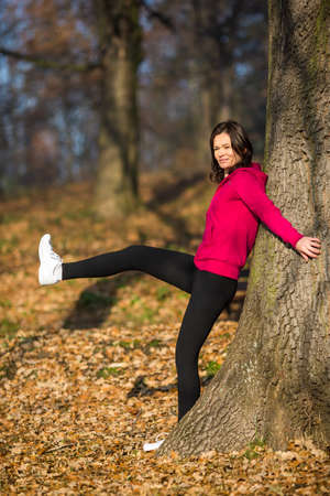 figure out: Woman exercising in park