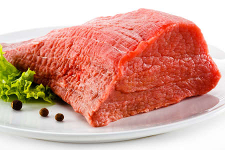 Raw beef and vegetables on white background Stock Photo - 23474926