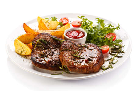 schnitzel: Grilled steaks, baked potatoes and vegetables