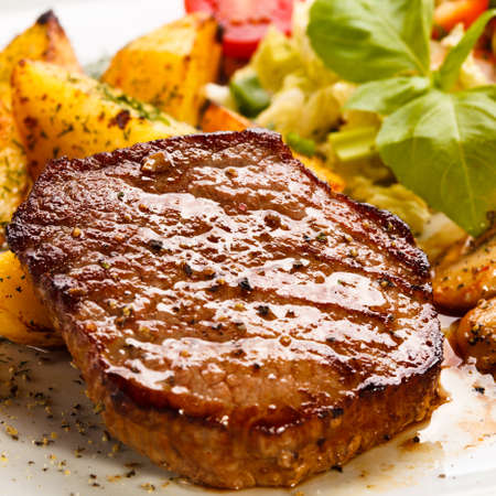pork loin: Grilled steak, baked potatoes and vegetables