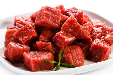 Raw beef on white background photo