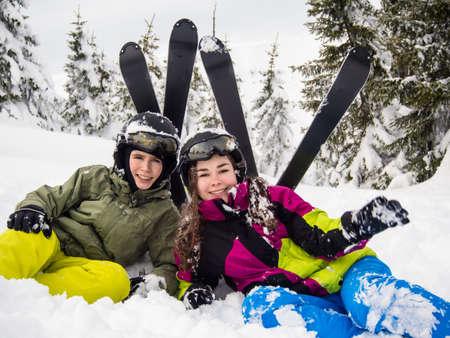 Teenage girl and boy skiing Stock Photo