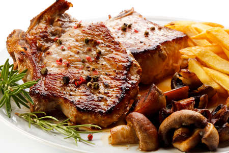 grilled potato: Grilled steaks, French fries and vegetables