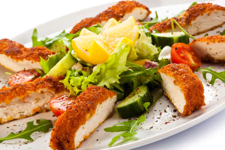 Fried chicken breast and vegetables photo