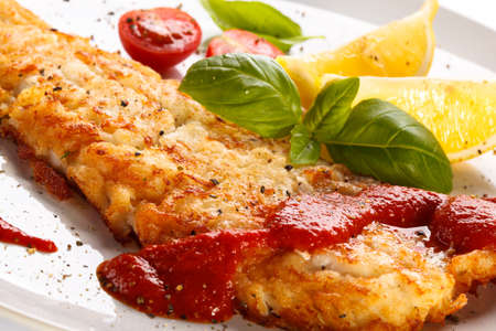 cod fish: Fish dish - fried fish fillet with vegetables