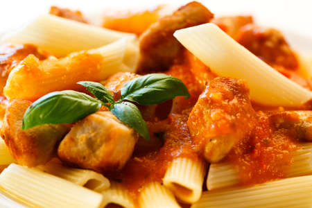 Pasta with roasted chicken and tomato sauce photo