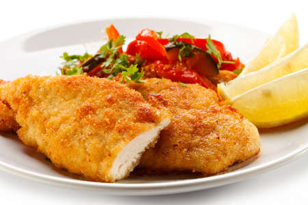 Fried chicken fillets and vegetables photo