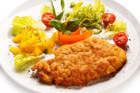 schnitzel: Fried pork chop and vegetable salad
