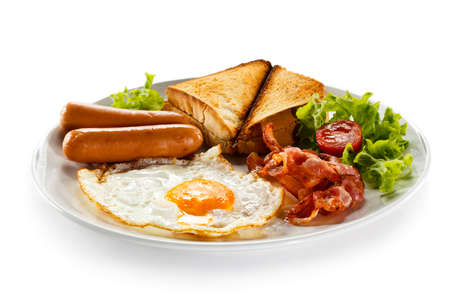 meat dish: English breakfast - toast, egg, bacon and vegetables