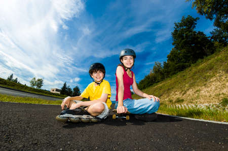 skateboarding tricks: Active young people - rollerblading, skateboarding