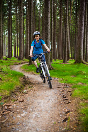 sporting activity: Healthy lifestyle - woman cycling