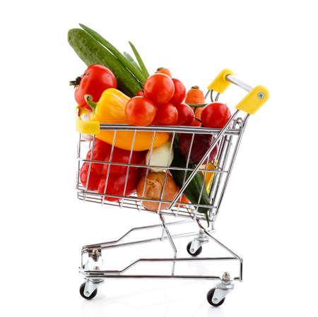 Caddy plein de légumes sur fond blanc Banque d'images - 24155133