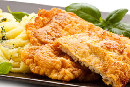 schnitzel: Fried pork chops, boiled potatoes and vegetable salad Stock Photo