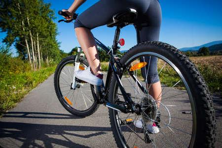 bike trail: Healthy lifestyle - young woman biking