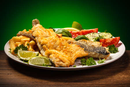 Fish dish - fried fish fillet and vegetables Stock Photo - 24355300