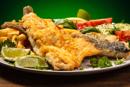 potato cod: Fish dish - fried fish fillet and vegetables Stock Photo