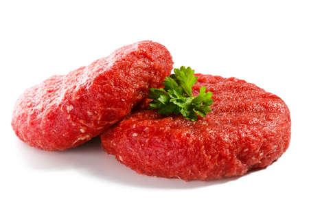 生の牛肉と野菜の白い背景の上 写真素材