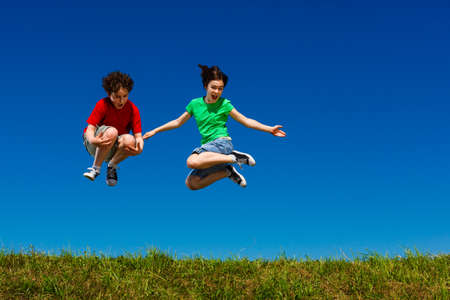 two boys: Girl and boy running, jumping outdoor