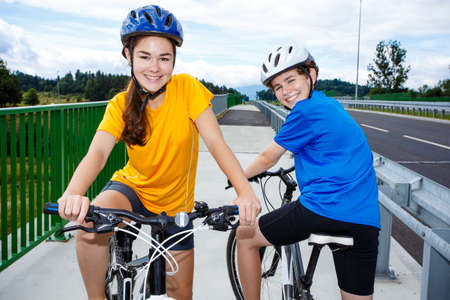 Healthy lifestyle - teenage girl and boy biking Stock Photo
