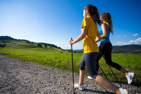 nordic: Nordic walking - active people working out outdoor