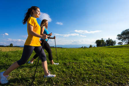 power walking: Nordic walking - active people working out outdoor
