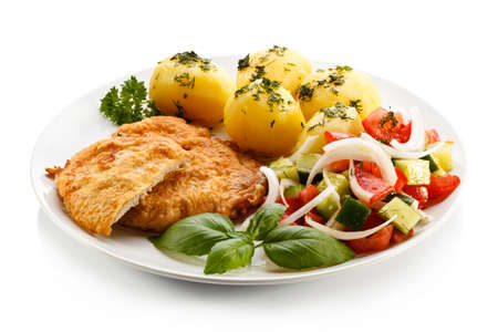 Fried pork chops, boiled potatoes and vegetable salad Stock Photo