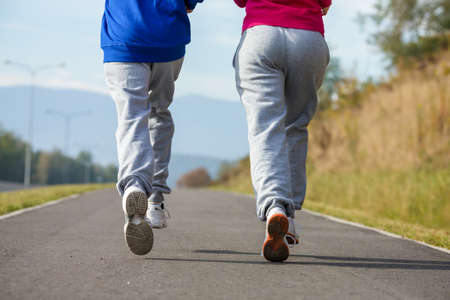 Healthy lifestyle - girl and boy running, jumping outdoor photo
