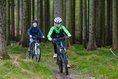 Healthy lifestyle - teenage girl and boy biking 版權商用圖片