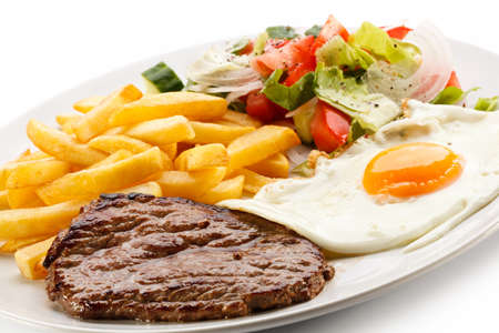 french fried potato: Grilled steaks, French fries, fried egg and vegetables