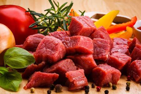 Raw beef and vegetables photo