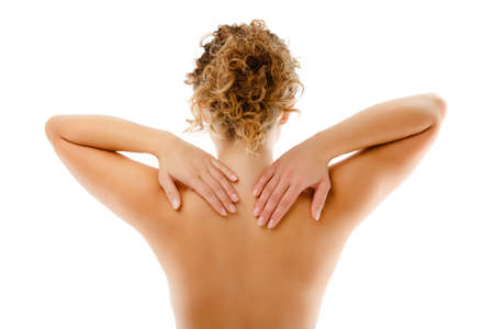 Woman massaging pain back isolated on white background photo