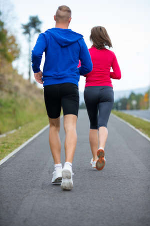 Healthy lifestyle - woman and man running photo