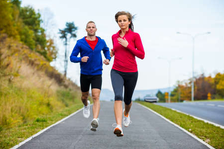 and the horizontal man: Healthy lifestyle - woman and man running  Stock Photo