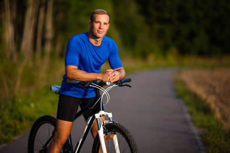 bicyclists: Healthy lifestyle - young man biking Stock Photo