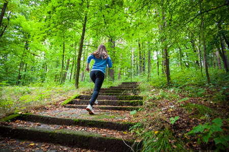 healthy girls: Young woman running in city park Stock Photo