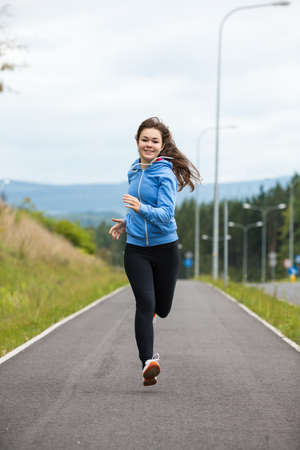 Urban leisure - girl running photo